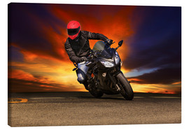 Canvas-taulu  Motorcyclist in a curve