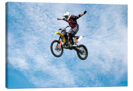 Canvas-taulu  Motorcycle racer jumping