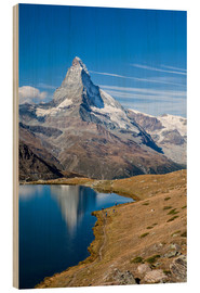 Puutaulu  Hikers walking on the path beside the Stellisee with the Matterhorn reflected. Zermatt Canton of Val - Roberto Sysa Moiola