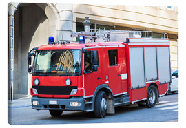 Canvas-taulu  Fire truck in action