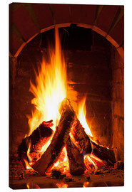 Canvas-taulu  Wood in the fireplace