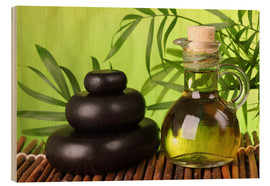 Puutaulu  Spa still life with hot stones and essential oil - Elena Schweitzer