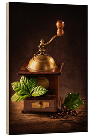 Puutaulu  Coffee mill with beans and green leaves and a cup of coffee - Elena Schweitzer