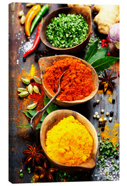 Canvas-taulu  Spices and herbs over wood