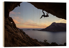 Puutaulu  Climber in a cave at sunset
